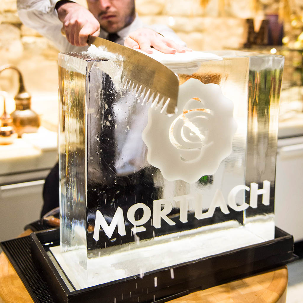 Mortlach branded ice block being carved