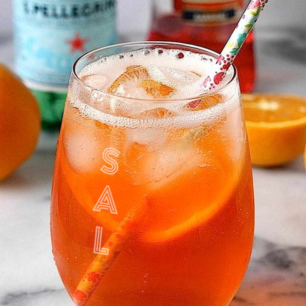 Sal branding, logo on glass of aperol spritz